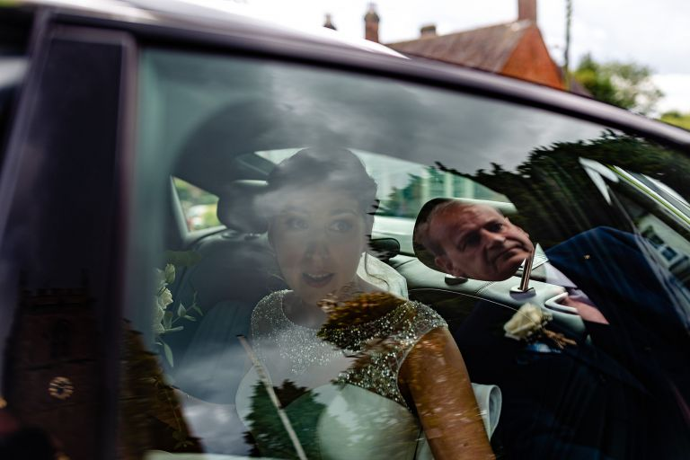 Bride arrives at the wedding ceremony in the wedding car